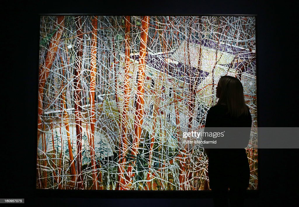 An employee looks at Peter Doig's 'The Architect's Home in the Ravine' ahead of their Post War and Contemporary art sale on February 8, 2013 in London, England. Christie's will hold an evening sale of these works on February 13, 2013 and a day sale on February 14, 2013.