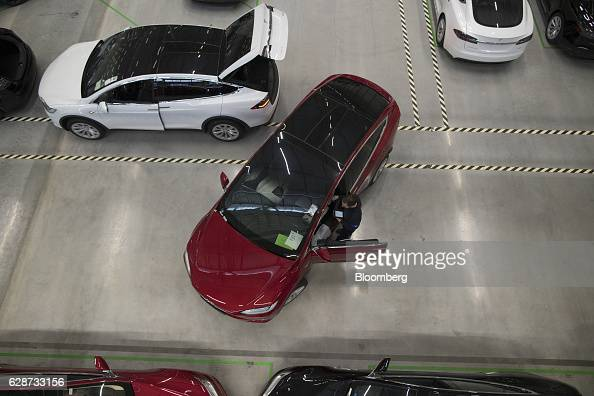 An employee looks inside a Tesla Model X sports utility vehicle following assembly for the European market at the Tesla Motors Inc factory in Tilburg...