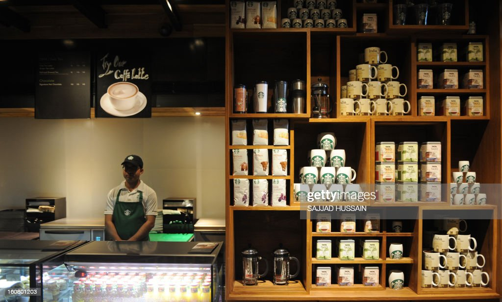 An employee looks on behind the counter at the newly-inaugurated Starbucks outlet in New Delhi on February 6, 2013. Starbucks, the world's biggest coffee chain, launched its first outlet in New Delhi on Wednesday with an aim to expand its reach to customers across India.