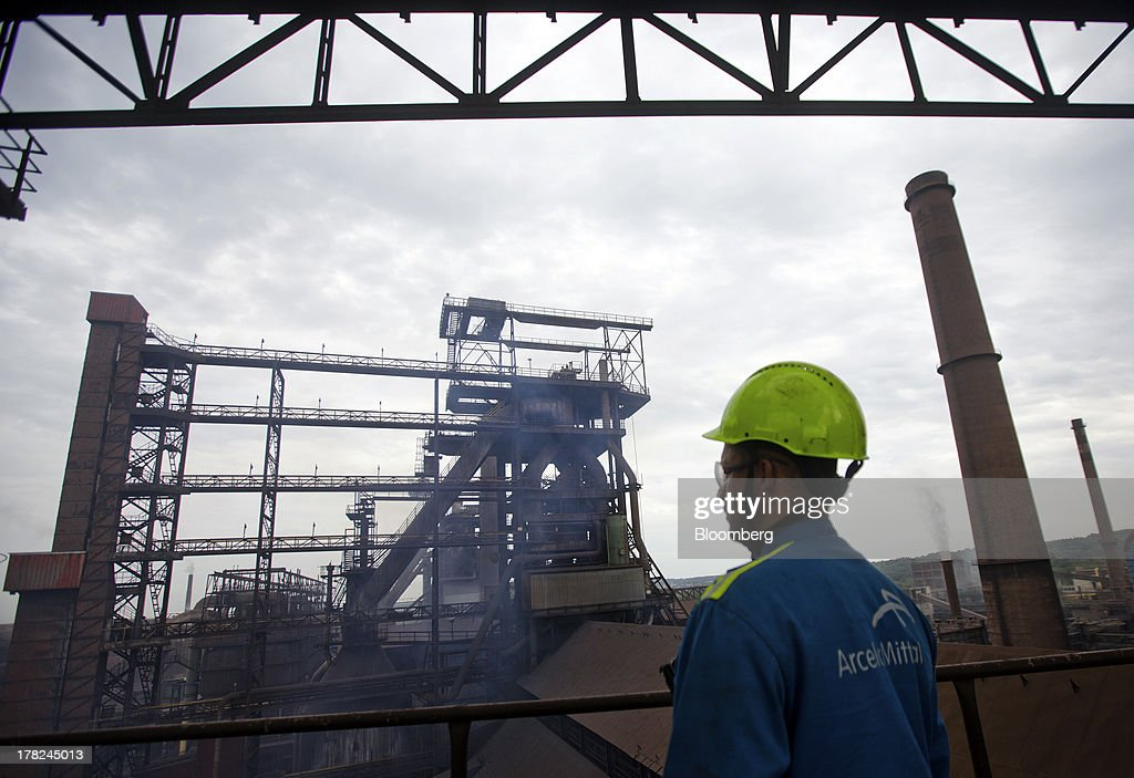 An employee looks out over part of ArcelorMittal's steel plant in Ostrava, Czech Republic, on Monday, Aug. 26, 2013. ArcelorMittal, the world's biggest steelmaker, said steel shipments will rise 1 percent to 2 percent this year compared with an earlier forecast of 2 percent in May. Photographer: Martin Divisek/Bloomberg via Getty Images