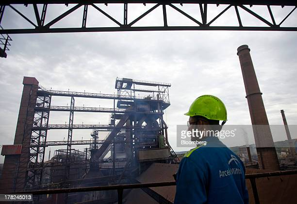An employee looks out over part of ArcelorMittal's steel plant in Ostrava Czech Republic on Monday Aug 26 2013 ArcelorMittal the world's biggest...