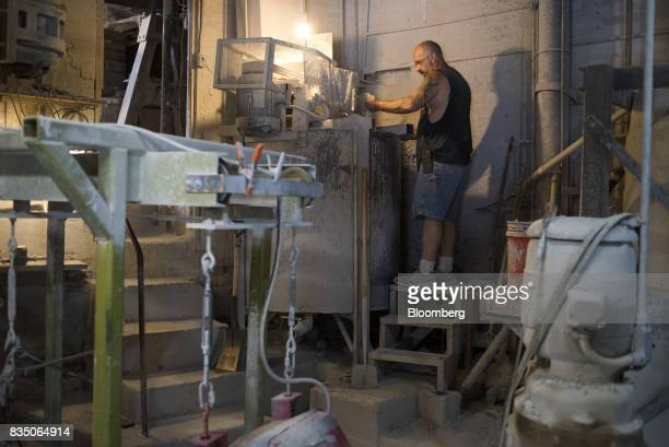 An employee makes a batch of slurry the substance which is used to pour into clay molds at American Mug Stein Co in East Liverpool Ohio US on Tuesday...