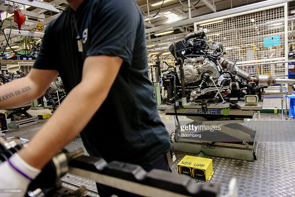An employee makes the final adjustments to an automobile engine before installation at the Volvo Cars plant in Torslanda, Sweden, on Thursday, Aug. 22, 2013. Volvo Cars Chief Executive Officer Hakan Samuelsson will settle a German investigation into corruption allegations linked to his tenure as MAN SE's CEO by paying 500,000 euros ($668,000) to charity. Photographer: Kristian Helgesen/Bloomberg via Getty Images
