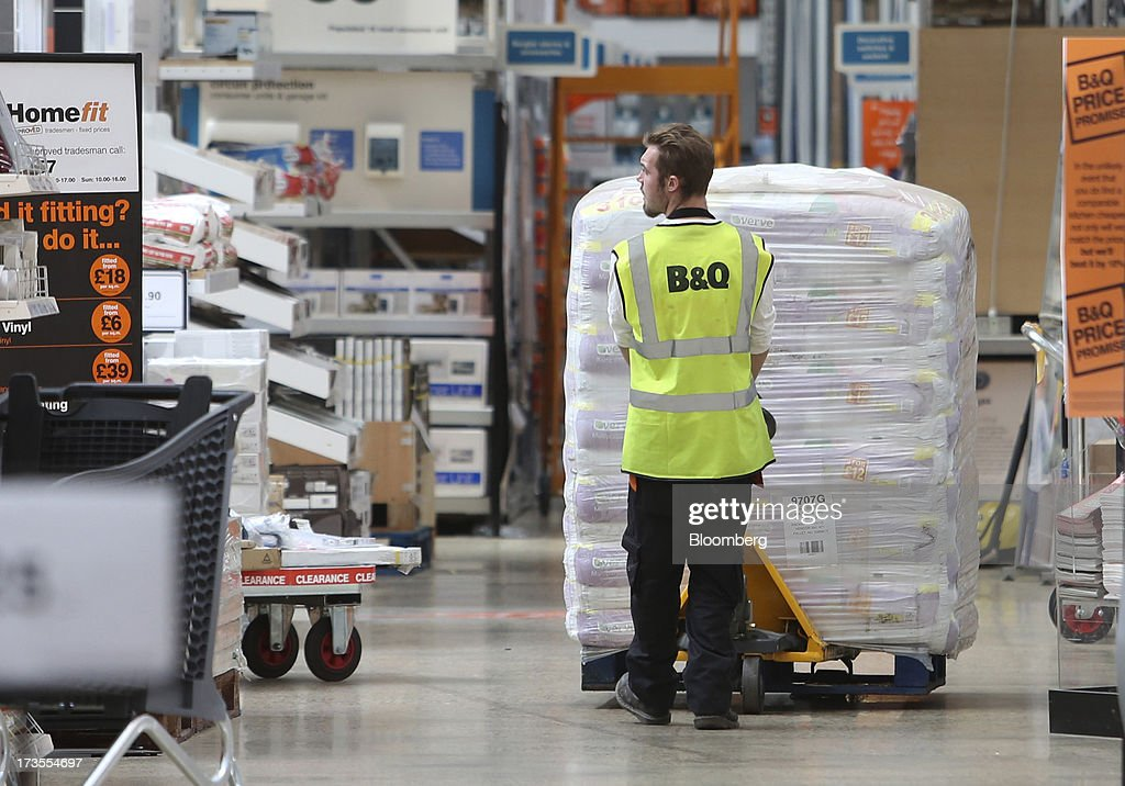 An employee maneuvers a pallet laden with bags of compost inside a B&Q home improvement store, operated by Kingfisher Plc, in London, U.K., on Tuesday, July 16, 2013. Financial assistance for first-time home buyers in Britain is likely to prompt a resurgence of do-it-yourself spending after several years of decline, according to Kingfisher Plc Chief Executive Officer Ian Cheshire. Photographer: Chris Ratcliffe/Bloomberg via Getty Images