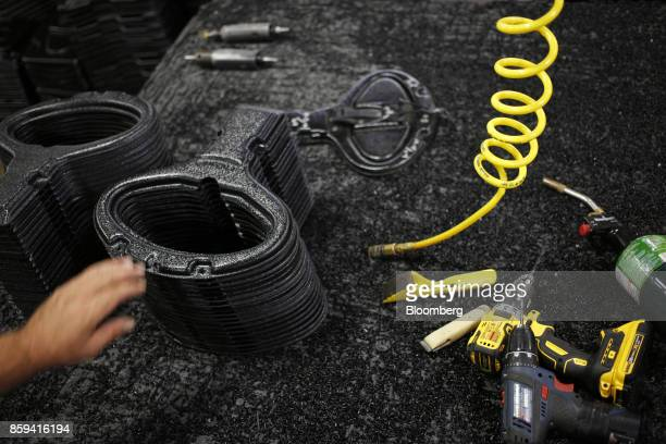 An employee manufactures components for plastic kayaks at the Jackson Kayak Inc factory in Sparta Tennessee US on Wednesday Oct 4 2017 Durable goods...