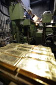 An employee melts gold bars on April 6 2009 at a plant of gold refiner and bar manufacturer ArgorHeraeus SA in Mendrisio southern Switzerland At...
