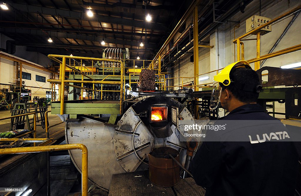 An employee monitors a furnace as cubes of shredded scrap copper are fed into it at the Luvata Malaysia Bhd. plant in Pasir Gudang, Johor, Malaysia, on Monday, May 13, 2013. At a time when copper stockpiles are rising to the highest in a decade, manufacturers are paying the biggest premiums for the metal in as much as seven years as financing deals lock up supply and extend lines at warehouses. Photographer: Munshi Ahmed/Bloomberg via Getty Images