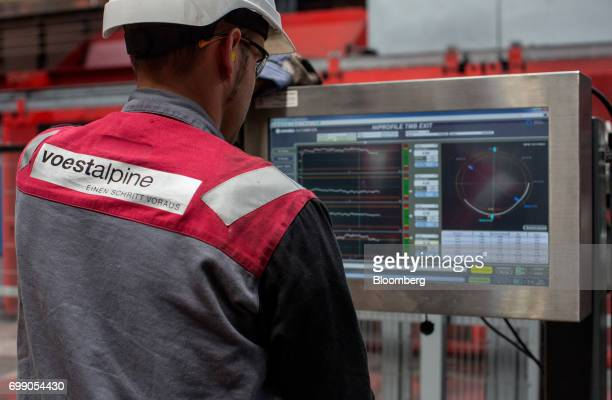 An employee monitors a screen as he operates a control module at the Voestalpine Wire Rod Austria GmbH plant in Sankt PeterFreienstein Austria on...