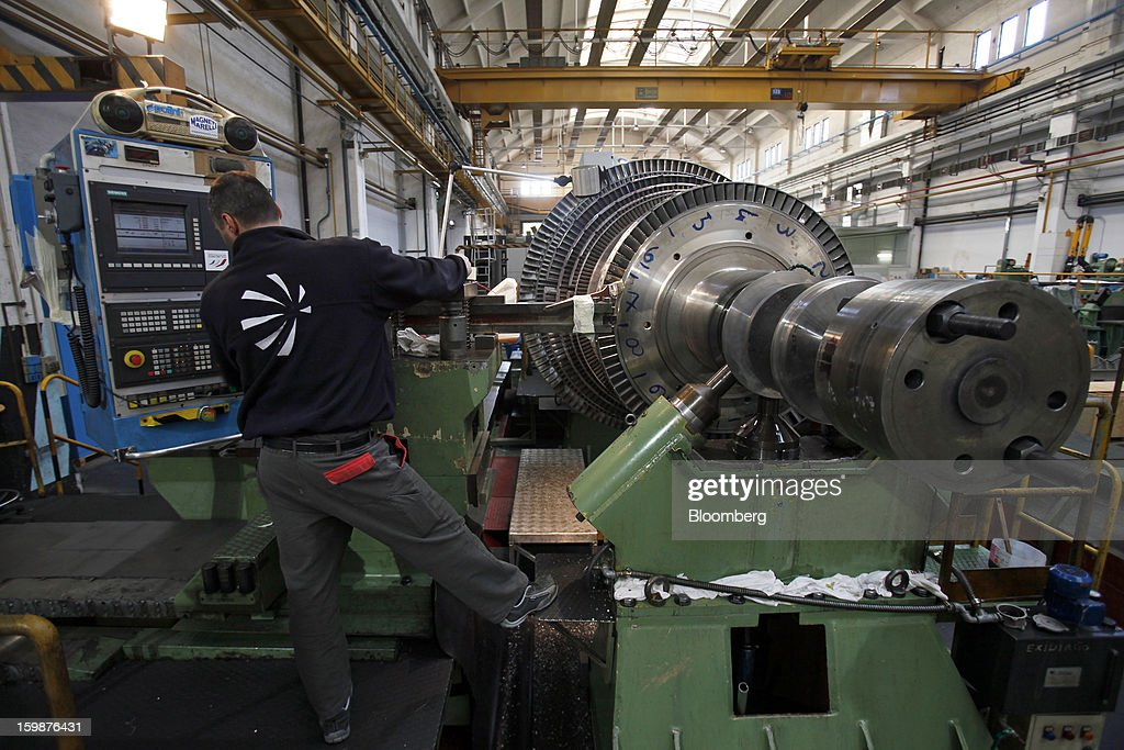 An employee monitors a screen as he test a steam turbine rotor shaft at Ansaldo Energia SpA's power-plant production facility in Genoa, Italy, on Friday, Jan. 18, 2013. Finmeccanica SpA is seeking binding bids for assets, including a majority stake in Ansaldo Energia, by Jan. 23, while a final decision will be made at a later board meeting, Ansa reported Jan. 16. Photographer: Alessia Pierdomenico/Bloomberg via Getty Images