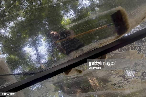 An employee mops a glass ceiling at Gaggan restaurant in Bangkok Thailand on Thursday May 4 2017 After his restaurant's third straight win in Asia's...