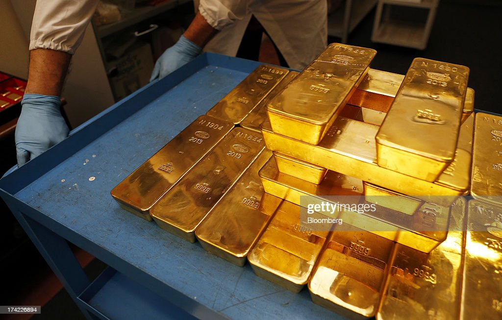 An employee moves a cart stacked with gold bars bearing the hallmark of Chimet SpA, the Italian goldsmith company, inside the precious metals refinery plant of Italpreziosi SpA in Arezzo, Italy, on Friday, July 19, 2013. Hedge funds raised bets on a gold rally before prices capped the biggest two-week gain in 20 months as Federal Reserve Chairman Ben S. Bernanke damped speculation that a cut in stimulus is imminent. Photographer: Alessia Pierdomenico/Bloomberg via Getty Images