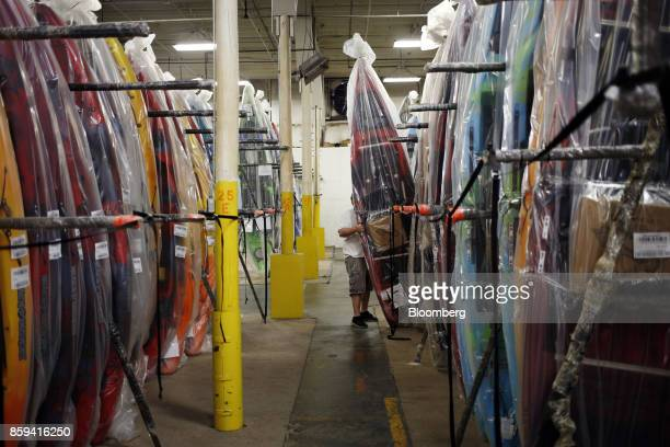 An employee moves a newly manufactured plastic kayak at the Jackson Kayak Inc factory in Sparta Tennessee US on Wednesday Oct 4 2017 Durable goods...