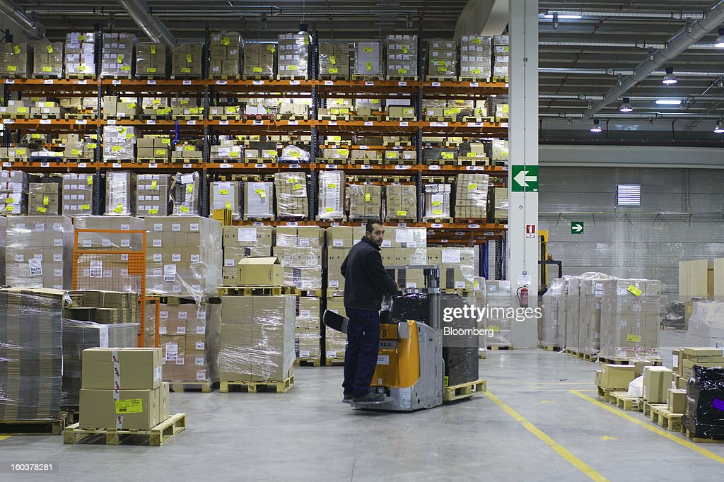 An employee moves a pallet past stores of pharmaceutical products at the Cofares SA logistical plant in Guadalajara, Spain, on Wednesday, Jan. 30, 2013. Madrid, the second-biggest contributor to Spain's economy after Catalonia, has sliced 1 billion euros from its budget in 2012, increasing public-transportation costs and university fees, cutting jobs, delaying investments and reducing health-care and social benefits. Photographer: Angel Navarrete/Bloomberg via Getty Images