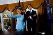 An employee moves a wax figurine of Senator Hillary Rodham Clinton next to one of Senator Barack Obama in a replica of the Oval Office at the Madame...