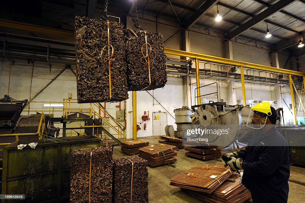 An employee moves cubes of shredded scrap copper towards a furnace at the Luvata Malaysia Bhd. plant in Pasir Gudang, Johor, Malaysia, on Monday, May 13, 2013. At a time when copper stockpiles are rising to the highest in a decade, manufacturers are paying the biggest premiums for the metal in as much as seven years as financing deals lock up supply and extend lines at warehouses. Photographer: Munshi Ahmed/Bloomberg via Getty Images