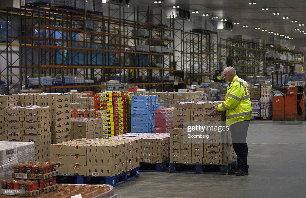 An employee moves goods inside WM Morrison Supermarkets Plc's distribution center in Wakefield, U.K., on Thursday, Nov. 22, 2012. Britain's economy will return to growth next year after stagnating in 2012, with expansion weighted in the second half, according to Bank of England projections published yesterday. Photographer: Simon Dawson/Bloomberg via Getty Images