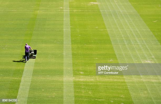 An employee mows the grass on the pitch of the Rostov Arena in the southern Russian city of RostovonDon on August 21 2017 The venue will host five...