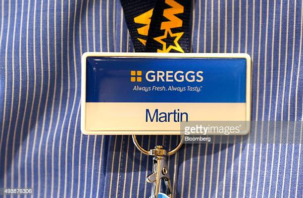 An employee name tag sits on a lanyard inside a Greggs Plc sandwich chain outlet in Caterham UK on Thursday Oct 22 2015 Samestore sales at Greggs...