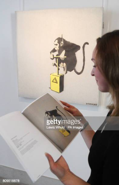 An employee near Banksy's Monkey Detonator that is expected to fetch 70000 90000 during a photocall for highlights from Bonhams Urban Art Sale on...