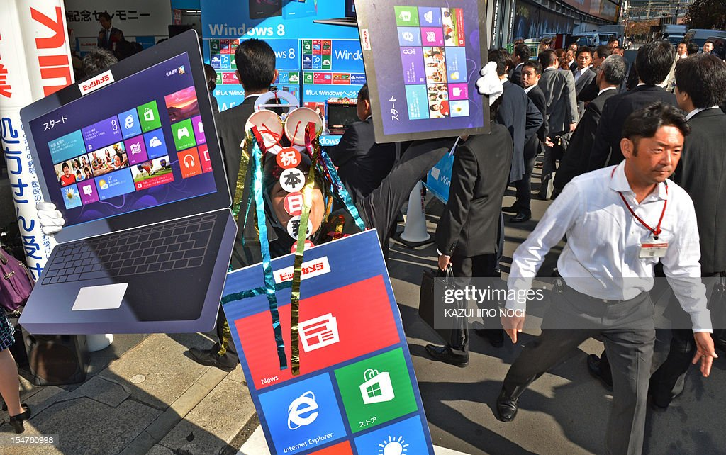 An employee of a camera chain promotes the release of Microsoft's new Windows 8 operating system in Tokyo on October 26, 2012. Microsoft announced that Windows 8 would launch on October 26 in 37 languages and 140 worldwide markets.