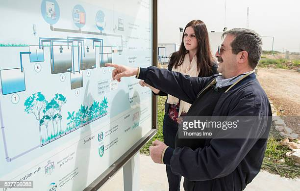 An employee of a decentralized sewage treatment plant in the Public Security Directorate explains its operating mode on April 06 2016 in Amman Jordan