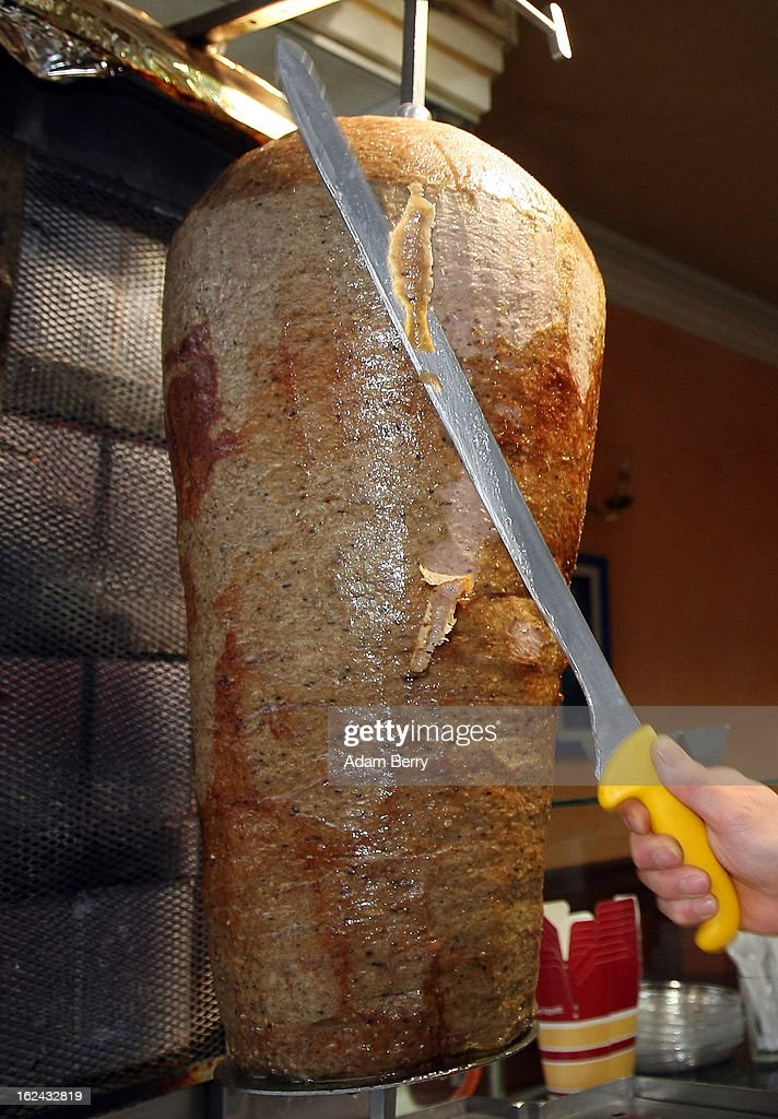An employee of a Doener kebab stand cuts meat for Doener sandwiches on February 23, 2013 in Berlin, Germany. The Europe-wide scandal over the contamination of beef products with horsemeat has reached the German capital, where, after laboratory tests, the latter has also been discovered in the city in two Doener sandwich stands and in frozen meat from a discount store. Authorities across the Continent continue to investigate the origin of ready-made lasagne that was labeled to contain only beef when it in fact also contained horsemeat.