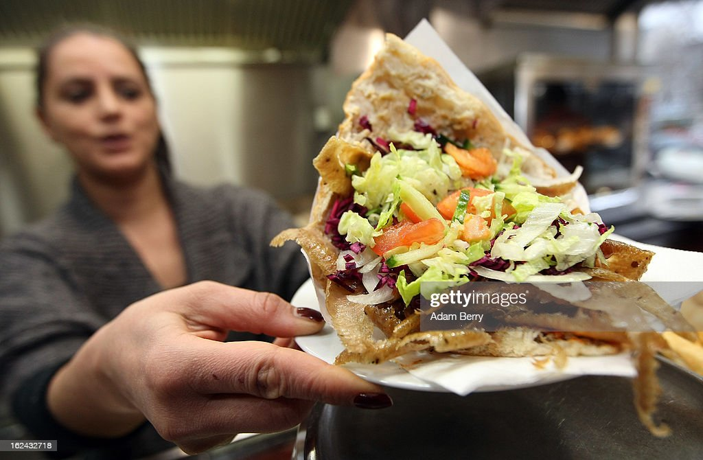 An employee of a Doener kebab stand serves a Doener sandwich on February 23, 2013 in Berlin, Germany. The Europe-wide scandal over the contamination of beef products with horsemeat has reached the German capital, where, after laboratory tests, the latter has also been discovered in the city in two Doener sandwich stands and in frozen meat from a discount store. Authorities across the Continent continue to investigate the origin of ready-made lasagne that was labeled to contain only beef when it in fact also contained horsemeat.