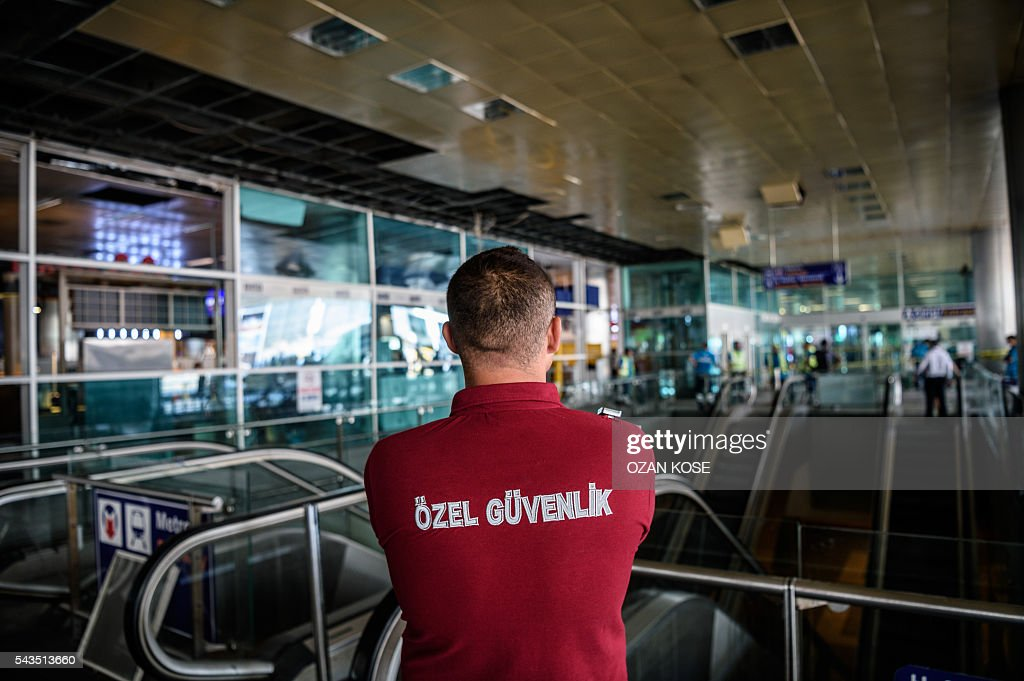 An employee of a private security company patrols Istanbul's Ataturk airport on June 29, 2016, a day after a suicide bombing and gun attack targeted Istanbul's airport, killing at least 36 people. A triple suicide bombing and gun attack that occurred on June 28, 2016 at Istanbul's Ataturk airport has killed at least 36 people, including foreigners, with Turkey's prime minister saying early signs pointed to an assault by the Islamic State group. / AFP / OZAN