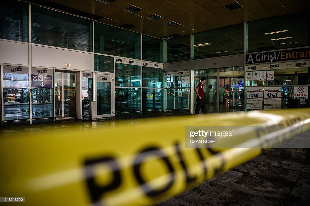 An employee of a private security company patrols outside Ataturk airport's international arrivals terminal on June 29, 2016, a day after a suicide bombing and gun attack targeted Istanbul's airport, killing at least 36 people. A triple suicide bombing and gun attack that occurred on June 28, 2016 at Istanbul's Ataturk airport has killed at least 36 people, including foreigners, with Turkey's prime minister saying early signs pointed to an assault by the Islamic State group. / AFP / OZAN