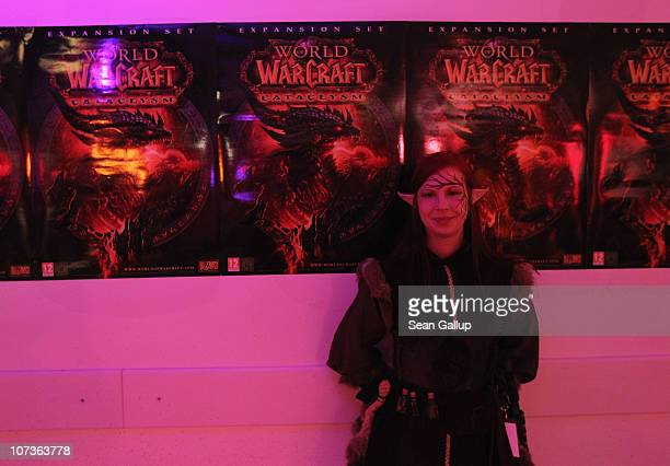 An employee of an event company dressed as a 'World of Warcraft' character waits for video gaming enthusiasts to arrive for the global sales premiere...