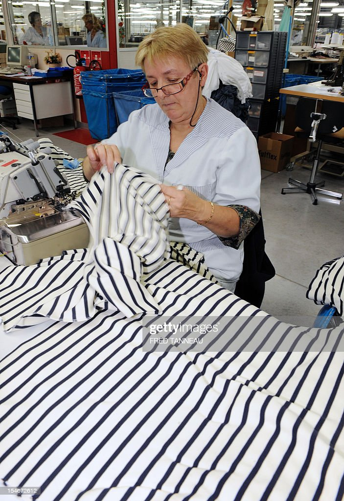An employee of Armor Lux, specialist of the Breton style knits, works on October 24, 2012 in Quimper, western France.