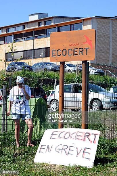 An employee of biological agriculture certification company Ecocert speaks on the phone during a rally outside the headquarters on April 13 2015 at...