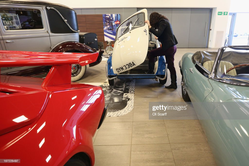 An employee of Bonhams auction house admires a 1959 BMW Isetta 300, which features in Bonhams' 'Important Motor Cars and Automobilia' auction, scheduled for Monday, December 3, 2012, in Mercedes-Benz World on November 30, 2012 in Weybridge, England. The auction also includes a Bladerunner RIB 35 Powerboat which was driven by footballer David Beckham as it carried the Olympic flame to the Olympic Stadium in the opening ceremony of the London 2012 Olympic Games.