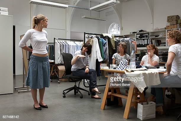 An employee of British couturier Margaret Howell models a simple white top in the company's retail flagship and design studio at 34 Wigmore Street...