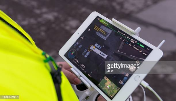 An employee of DEKRA controls a drone over a spare bus during the reconstruction of the attack on Borussia Dortmund football team's bus in Dortmund...