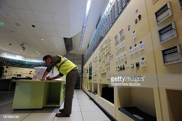 An employee of EDF a French electric utility company works in a control room simulator at the Fessenheim nuclear powerplant during a nuclear accident...