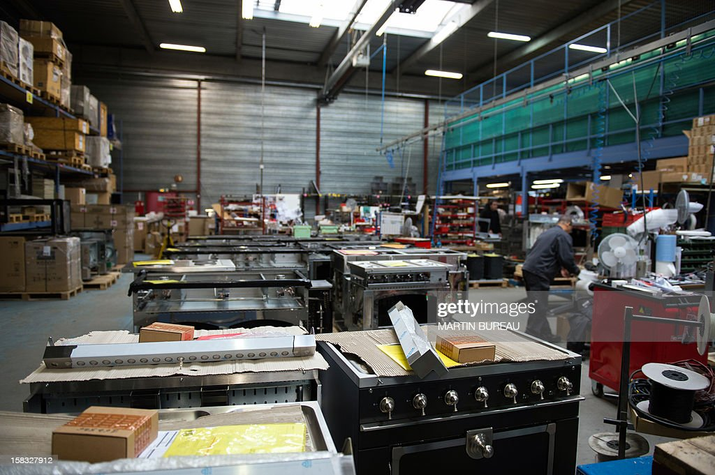 An employee of French cooker maker 'La Cornue' works in the factory on December 13, 2012, in Saint-Ouen-l'Aumone, north of Paris.