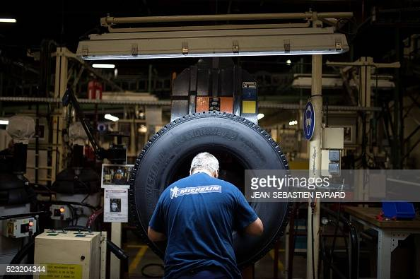 An employee of French tyre maker Michelin works on April 22 2016 at the Michelin truck tires factory of La rochesurYon western France The plant...