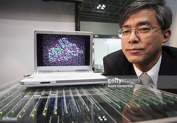 An employee of Fujitsu shows the BioServer a powerful new computer that will be able to handle the large amount of calculations currently needed in...