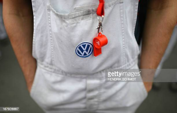 An employee of German car manufacturer Volkswagen takes part in a warning strike in Chemnitz eastern Germany on May 2 2013 Powerful union IG Metall...