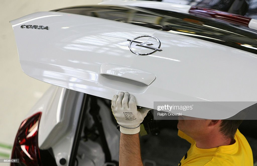 An employee of German carmaker Adam Opel GmbH works on an Opel Corsa at a plant on May 4, 2009 in Eisenach, Germany. Representatives of the German government, officials of car manufacturer Opel and managers of Italian carmaker Fiat will meet today in Berlin to discuss a merger between Fiat, Opel and U.S. carmaker Chrysler.