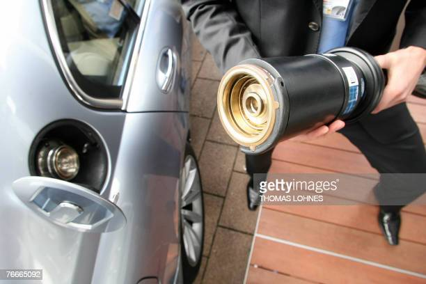 An employee of German chemicals maker Linde demonstrates the hydrogenfuelling of a BMW Hydrogen 7 car at the 62nd International Motor Show 11...