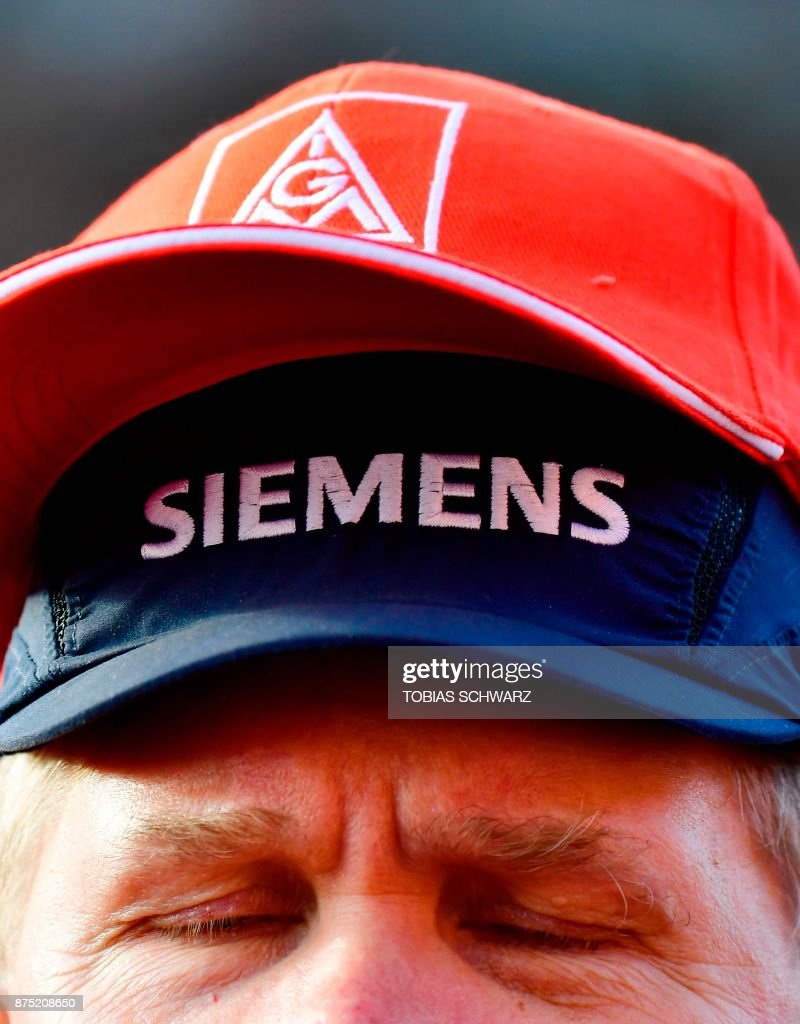Protest as German industrial conglomerate Siemens said it would slash around 6,900 jobs