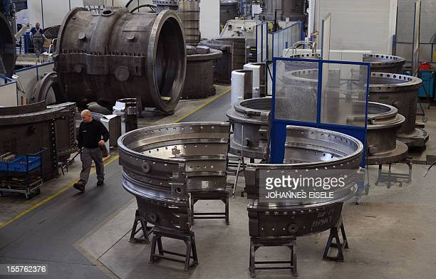 An employee of German industrial giant Siemens works on a housing of a Gas Turbine in the turbine plant on November 8 2012 in Berlin German...