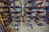 An employee of German multinational group Siemens works in a storage warehouse of the Siemens site of Haguenau eastern France on June 19 during a...