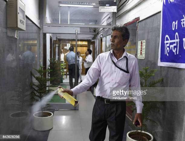 An employee of Health Ministry sprays roomfreshener before the arrival of Union Minister of State for Health and Family Welfare Ashwini Kumar Choubey...