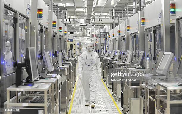 An employee of Japan's microprocessor maker Renesas Electronics works at the company's Naka wafer fabrication factory in Hitachinaka Ibaraki...