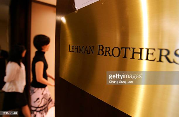 An employee of Lehman Brothers Seoul office walk past at their office September 16 2008 in Seoul South Korea The Korean stock markets has plummeted...