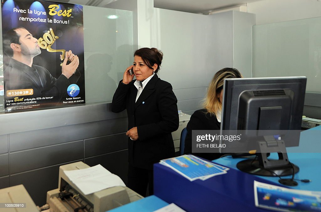 An employee of mobile operator Tunisie Telecom , uses a mobile phone in a store, on May 25, 2010 in Tunis.
