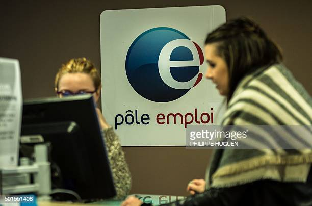 An employee of Pole Emploi French national employment agency speaks with an unemployed woman at an agency in Lille northern France on December 16...
